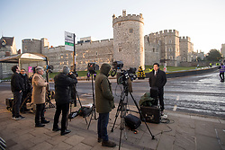 © Licensed to London News Pictures. 17/04/2021. Windsor, UK. Media starts to gather in the early morning outside Windsor Castle in Windsor, Berkshire, ahead of the funeral of Prince Philip, The Duke of York. Prince Philip, the Consort of the longest reigning English monarch in history, Queen Elizabeth II, died on 9 April 2021, two months before his 100th birthday. . Photo credit: Ben Cawthra/LNP