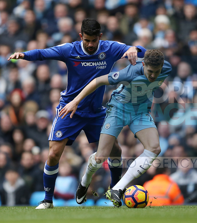 Diego Costa of Chelsea and John Stones of Manchester City during the Premier League match at the Etihad Stadium, Manchester. Picture date: December 3rd, 2016. Pic Simon Bellis/Sportimage