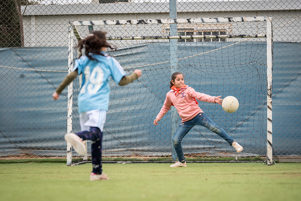 20 February 2020, Za'atari Camp, Jordan: A girl tries to save a penalty during football practice for girls in the Peace Oasis, a Lutheran World Federation space in the Za'atari Camp where Syrian refugees are offered a variety of activities on psychosocial support, including counselling, life skills trainings and other activities.
