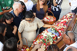 December 3, 2016 - Rio De Janeiro, Brazil - Carol, the journalist's wife had 2 children with him and was pregnant with the third. Body of journalist Guilherme Van Der Laars, from TV Globo, is buried in the São João Batista Cemetery, in Botafogo. He was one of the victims of the plane crash that would take the Chapecoense team to the final of the Copa Sudamericana in Colombia. The Lamia plane, which specializes in transporting football teams, crashed near the airport of destination and the first investigations realize that the fall was caused by lack of fuel. The case continues to be investigated by the Brazilian and Colombian authorities. This Saturday, Brazil was moved by the wake and the burial of dozens of athletes, journalists and members of the Chapecoense soccer team.  Rio de Janeiro, Brazil, December 03, 2016. (Credit Image: © Luiz Souza/NurPhoto via ZUMA Press)