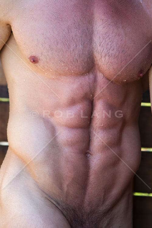 bodybuilder's torso in a shower