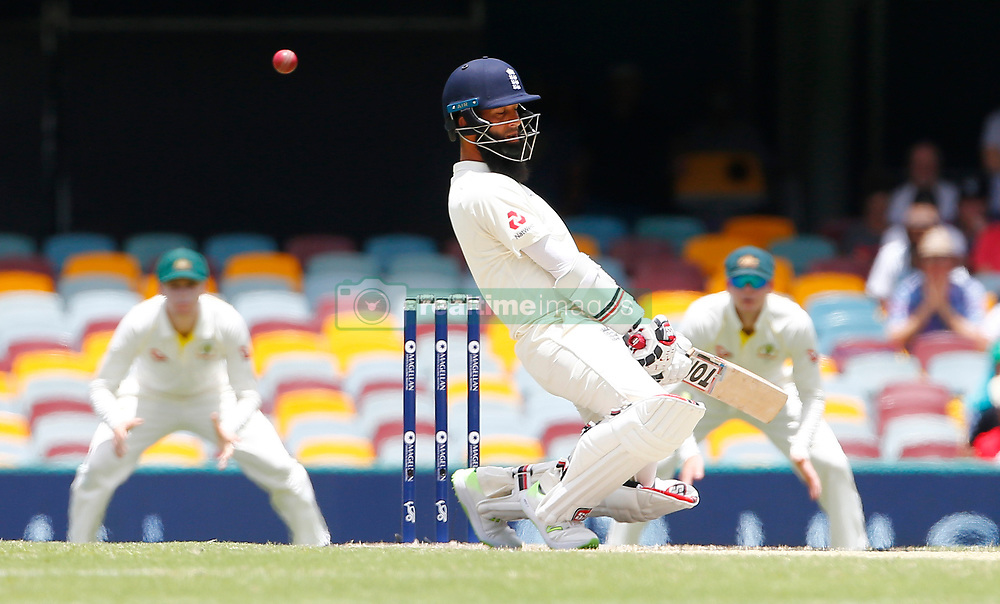 England's Moeen Ali ducks a bouncer during day four of the Ashes Test match at The Gabba, Brisbane.