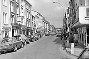 High Street Killarney in the 1980's.<br /> Photo: macmonagle.com archive<br /> <br /> Killarney Now & Then - MacMONAGLE photo archives.<br /> Facebook - @killarneynowandthen