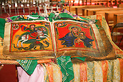 Africa, Ethiopia, Lalibela, Interior of Rock Hewn church of Bete Maryam. Religious art on display Old bible scroll