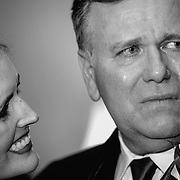 A father cries as his daughter looks on during a wedding at Jekyll Island in this black-and-white photograph.  ©Travis Bell Photography