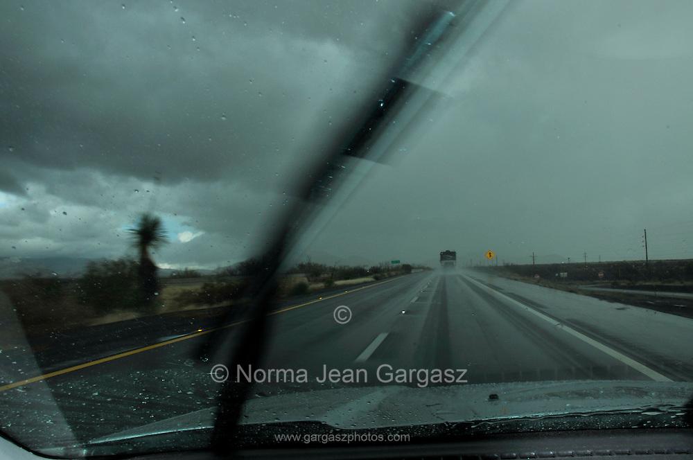 Traffic moves through rain on Interstate 10 in Benson, Arizona, USA.