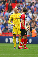 Football - 2017 / 2018 FA Cup - Semi Final: Chelsea vs. Southampton<br /> <br /> Southampton's Charlie Austin and Willy Caballero of Chelsea discuss the decision to disallow a goal for Austin due to him fouling the Chelsea keeper at Wembley Stadium <br /> <br /> COLORSPORT/SHAUN BOGGUST