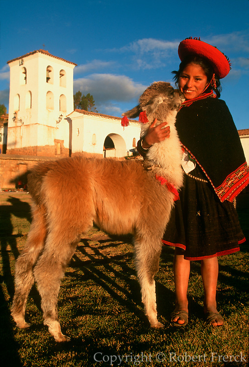 PERU, MARKETS AND CRAFTS Chincheros, Quechua girl and llama