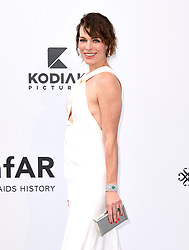 Milla Jovovich attending the 26th amfAR Gala held at Hotel du Cap-Eden-Roc during the 72nd Cannes Film Festival. Picture credit should read: Doug Peters/EMPICS