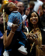 PHOTO BY DAVID RICHARD.LeBron James Jr. watches streamers fall from the rafters of Quicken Loans Arena after the Cleveland Cavaliers defeated visiting Miami April 1, 2006.