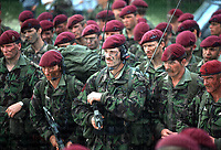 Soldiers of the 1st Battalion Parachute regiment and airborne forces are briefed before an exercise in May 1990. They are equipped with SA80 rifles and DPM camouflage. Note on their famous maroon berets a darkened cap badge, which was only issued for combat scenarios to hinder unnecessary shine. Photograph by Terry Fincher
