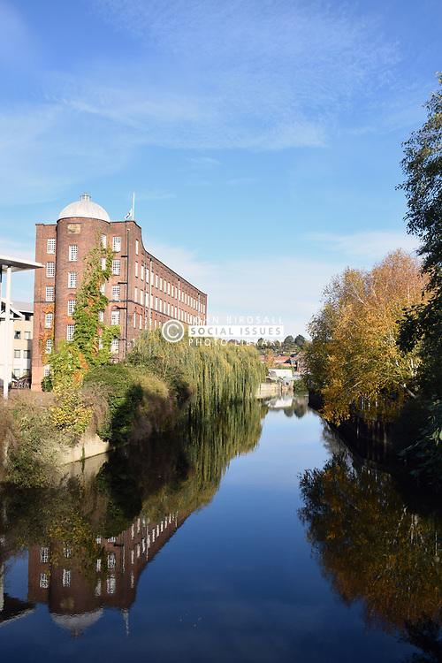 Autumn colours, River Wensum, old Jarrold mill, Norwich UK November 2019