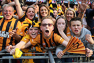 Hull City fans celebrate in the stands after their  team get promoted to the premier league. Skybet football league Championship play off final match, Hull city v Sheffield Wednesday at Wembley Stadium in London on Saturday 28th May 2016.<br /> pic by John Patrick Fletcher, Andrew Orchard sports photography.