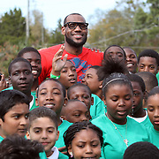 NBA All Star LeBron James poses with kids at an event at the Boys & Girls Club of Central Florida on Saturday, Feb. 25, 2012 in Orlando, Florida. The LeBron James Family Foundation and Sprite donated sporting equipment and introduced a new baseball diamond, renovated play area and a picnic area.  (AP Photo/Alex Menendez)