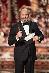 March 4, 2018 - Hollywood, California, U.S. - Mark Bridges accept the Oscar for achievement in costume design for work on Phantom Thread during the live ABC Telecast of The 90th Oscars at the Dolby Theatre in Hollywood. (Credit Image: ? Aaron Poole/AMPAS via ZUMA Wire/ZUMAPRESS.com)