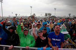 28 April 2013. New Orleans, Louisiana,  USA. .A rain soaked New Orleans Jazz and Heritage Festival. The crowd cheers on The Dave Matthews Band..Photo; Charlie Varley.