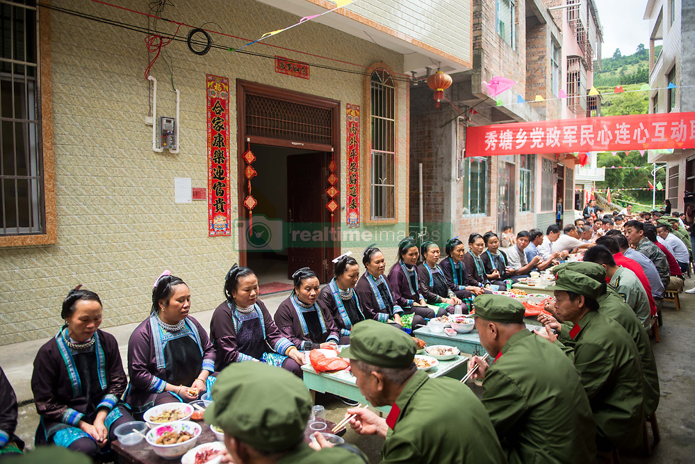 August 1, 2018 - Congjiang, China - Veterans enjoy the long table feast in Congjiang, southwest China's Guizhou Province, marking the Army Day. The China's Army Day is celebrated on August 1st every year to commemorate the foundation of  People's Liberation Army (PLA) (Credit Image: © SIPA Asia via ZUMA Wire)