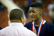 Dallas Kimball head coach Royce Johnson has words with D'Angelo Allen (3) after a close lose to Rosenberg Terry in the UIL 4A state championship game at the Frank Erwin Center in Austin on Saturday, March 9, 2013. (Cooper Neill/The Dallas Morning News)