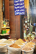 Spices and nuts for sale at a stall in a souq in the Old City in Damascus, Syria