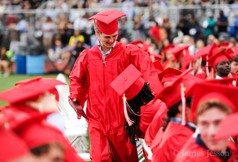 Isaac Weycker is congratulated by classmates during the 148th Graduation exercises at Wellesley High School on June, 2, 2017.   [Wicked Local Photo/James Jesson]