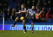Brentford midfielder Alan Judge, Brighton defender, Bruno Saltor (2) during the Sky Bet Championship match between Brighton and Hove Albion and Brentford at the American Express Community Stadium, Brighton and Hove, England on 5 February 2016.