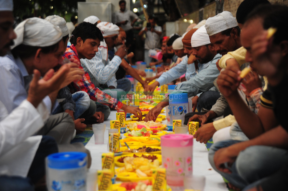 """June 16, 2017 - Allahabad, Uttar Pradesh, India - Muslims break their fast with """"iftar"""" during the holy month of Ramadan at. Muslim men and women across the world observe Ramadan, a month-long celebration of self-purification and restraint. (Credit Image: © Prabhat Kumar Verma/Pacific Press via ZUMA Wire)"""