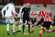 referee Roger East © keeps a close eye on the action. Premier league match, Swansea city v Southampton at the Liberty Stadium in Swansea, South Wales on Tuesday 31st January 2017.<br /> pic by  Andrew Orchard, Andrew Orchard sports photography.
