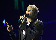 """Westlife Greatest Hits / Farewell Tour 2012 at the Metro Radio Arena Newcastle..15-06-12... ..Kian Egan of  Irish Super Group Westlife perform during their sell out show at the Metro Radio Arena, in the English Leg of their Greatest Hits / Farewell World Tour. ..Westlife are an Irish boy band formed in 1998. They are to disband in 2012 after their farewell tour. The group's line-up was Shane Filan, Mark Feehily, Kian Egan, and Nicky Byrne. Brian McFadden was part of the group until 2004. Westlife have sold over 45 million records worldwide which includes studio albums, singles, video release, and compilation albums.. Despite the group's worldwide success, they only have one hit single in the United States, """"Swear It Again"""", which peaked in 2000 on the Billboard Hot 100 at number 20. The band were originally signed by Simon Cowell and are managed by Louis Walsh. The group have accumulated 14 number-one singles in the United Kingdom, the third-highest in UK history, tying with Cliff Richard..The group had also broken a few records, including """"Music artist with most consecutive number 1's in the UK"""", which consists of their first seven singles and only behind The Beatles and Elvis Presley..The band have 14 UK number ones and 25 top ten singles, consisting of 20.2 million records and videos in the UK across their 14-year career - 6.8 million singles, 11.9 million albums and 1.5 million videos. The Band are best known for amazing songs such as Flying Without Wings and Safe......At The Metro Radio Arena, Newcastle. England..Picture  Mark Davison/ ProLens PhotoAgency/ PLPA..Friday 15th June 2012."""