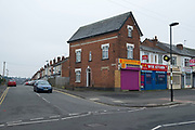 Chinese restaurants on a street corner in Birmingham, United Kingdom.