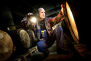 Peter Hurup inspects barrels at the Aalborg factory.<br /> Photo Ola Torkelsson ©