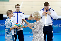 The Duchess of Cornwall (right) presents medals to Scotland's Neil Fachie and pilot Matt Rotherham after the Men's B&VI 1000m Time Trial at the Anna Meares Velodrome during day one of the 2018 Commonwealth Games in the Gold Coast, Australia.