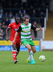 Tom Bolarinwa of Grimsby Town applies pressure on Matthew Dolan of Yeovil Town  - Mandatory by-line: Nizaam Jones/JMP - 29/10/2016/ - FOOTBALL - Hush Park - Yeovil, England - Yeovil Town v Grimsby Town - Sky Bet League Two