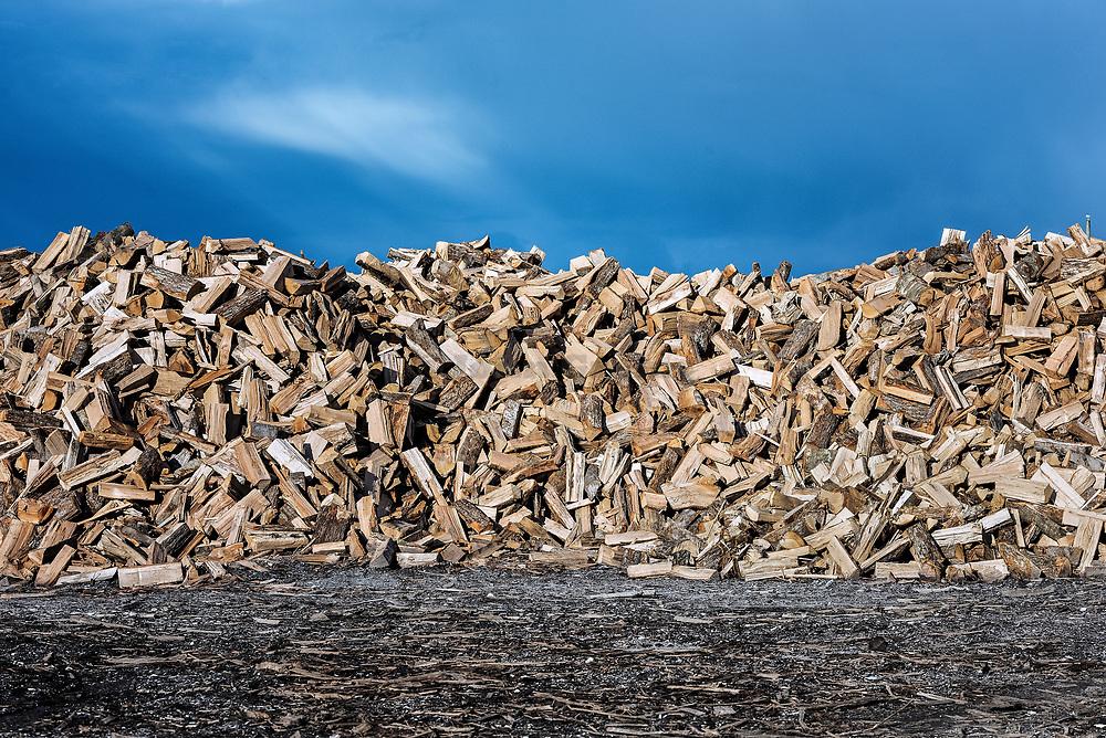 Large stack of split firewood.
