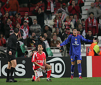 Photo: Lee Earle.<br /> Benfica v Manchester United. UEFA Champions League.<br /> 07/12/2005. United's Cristiano Ronaldo (R) shows his frustration after the ref decided he fouled.