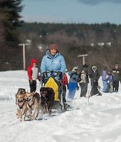 Governor Maggie Hassan enjoys the thrill of a dog sled ride prior to the start of the Open series racing during Laconia's 85th annual World Championship Sled Dog races on Sunday afternoon.  (Karen Bobotas/for the Laconia Daily Sun)