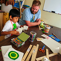 071614  Adron Gardner/Independent<br /> <br /> Matix Shirley, 6, looks over a booklet before painting it with Russ Ouellett for an art party at the Expressive Arts Studio in Gallup Wednesday.
