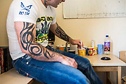 A prisoner makes a cup of tea in his cell. HMP/YOI Portland, Dorset, United Kingdom.