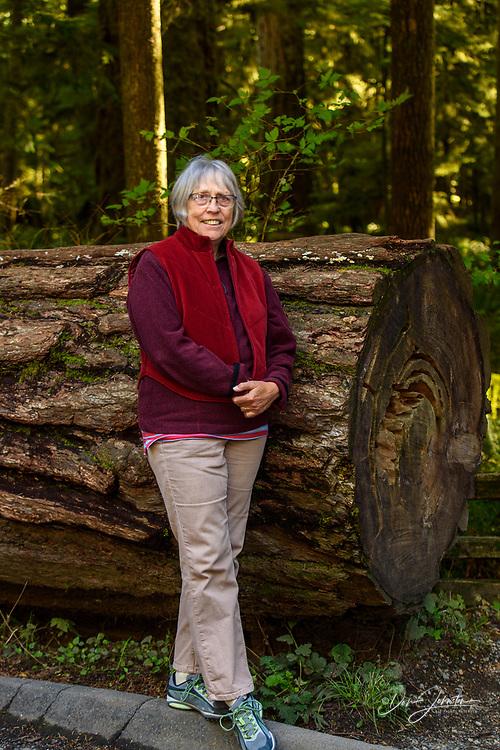 Cathedral Grove scenics- Giant cedar and visitor, MacMillan Provincial Park, Nanaimo, British Columbia, Canada