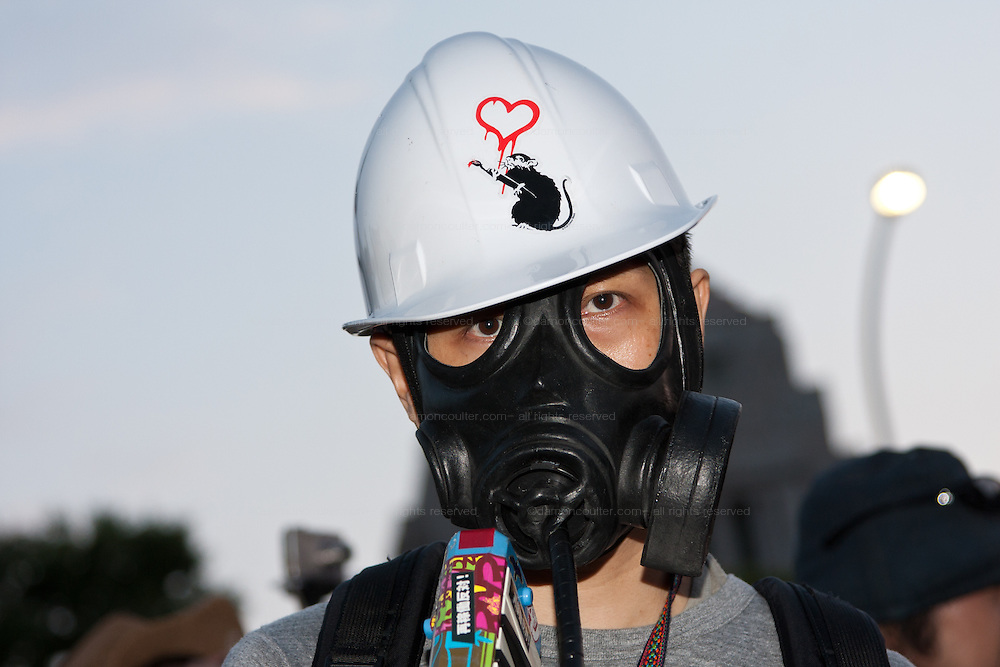 A protester wears a helmet and gas mask at an anti nuclear protest around the National Diet Building in Kasumigaseki, Tokyo, Japan Sunday June 2nd 2013