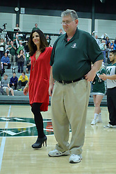 21 February 2017:  Mat the Cat Adams gets escorted to the floor during an College men's division 3 CCIW basketball game between the Augustana Vikings and the Illinois Wesleyan Titans in Shirk Center, Bloomington IL
