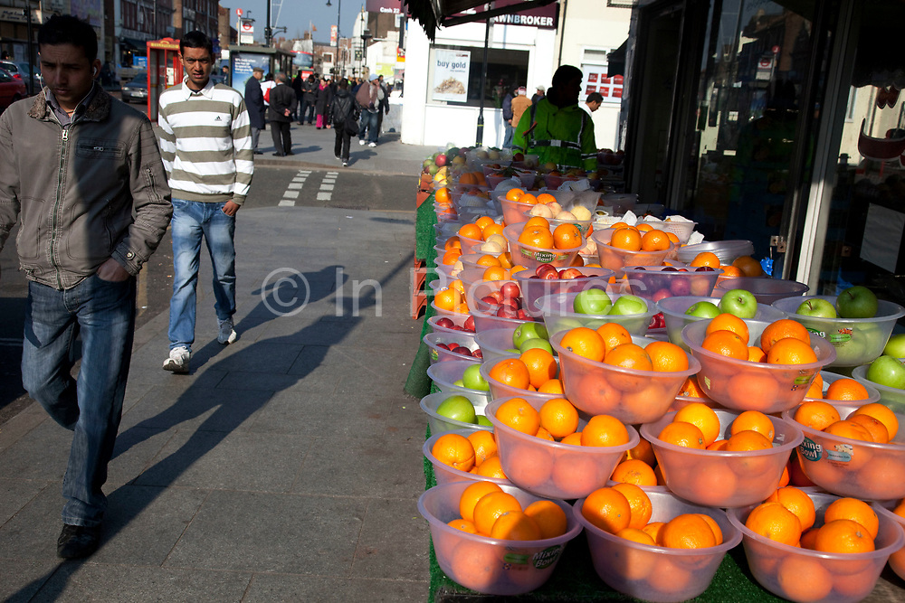 Fruit for sale in Southall in West London, also known as 'Little India' by some, is an area almost completely populated by people from South Asia. Figures show that the area is approximately 50 percent Indian in origin although walking the streets it would appear far higher as the local people go about their shopping in the many shops specialising in goods specific to this culture. The mix of religions is mainly Sikh, Hindu and Muslim.<br /> <br /> Southall is primarily a South Asian residential district. 1950 was when the first group of South Asians arrived in Southall, reputedly recruited to work in a local factory owned by a former British Indian Army officer. This South Asian population grew due to the closeness of expanding employment opportunities. The most significant cultural group to settle in Southall are Indian Punjabis.