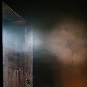 Smoke rises outside of Radhika's house.