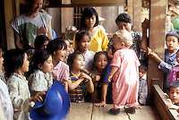 western boy with new Vietnamese friends, Son La, Vietnam