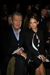 File photo : Mario Testino and Nicole Richie front row at the Givenchy Fall-Winter 2013/2014 Ready-To-Wear collection show held at the Halle Fressinet, in Paris, France on March 3, 2013. Photographer to the stars Mario Testino is a favourite of the Royal Family but he is facing a stream of sexual misconduct allegations from male models. Fashion brands Burberry and Michael Kors moved quickly to cut ties with him. He had been a front-runner to be the official photographer at the wedding of Prince Harry and Meghan Markle but has been ruled out following the uproar. Photo by Thierry Orban/ABACAPRESS.COM