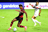 SAO PAULO, BRAZIL - FEBRUARY 25: Bruno Henrique of CR Flamengo competes for the ball with Dani Alves of Sao Paulo FC ,during the Brasileirao Serie A 2020 match between Sao Paulo FC and CR Flamengo at Morumbi Stadium on February 25, 2021 in Sao Paulo, Brazil. (Photo by MB Media/BPA)