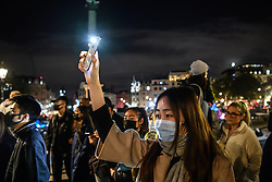 © Licensed to London News Pictures. 04/10/2019. London, UK. Demonstrators assembled in Trafalgar Square to take part in an emergency action protesting the new anti mask law passed  today by the Hong Kong administration banning the covering of faces in all public gatherings. Protesters called for the UK and the World to stand with Hong Kong to protect their autonomy as part of the 'One country, two system' model. Photo credit: Guilhem Baker/LNP