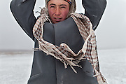 A Kyrgyz man come to greet us, in -30C. Between Ortobil and Kyzyl Qorum...Trekking with yak caravan through the Little Pamir where the Afghan Kyrgyz community live all year, on the borders of China, Tajikistan and Pakistan.