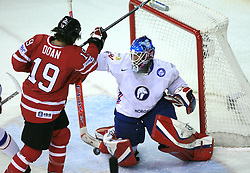 Shane Doan of Canada vs Pal Grotnes of Norway at play-off round quarterfinals ice-hockey game Norway vs Canada at IIHF WC 2008 in Halifax,  on May 14, 2008 in Metro Center, Halifax, Nova Scotia,Canada. (Photo by Vid Ponikvar / Sportal Images)