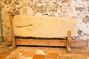 Decorated Saxon stone cross shaft monument inside church of Saint Botolph, Iken, Suffolk, England, UK