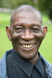 Portrait of a older man in the park smiling,